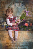 Little girl  with a bouquet of tulips in hands Royalty Free Stock Images