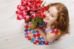 Little girl with bouquet of tulips. Royalty Free Stock Images