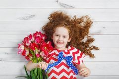 Little girl with bouquet of tulips. Mothers day concept, holiday Royalty Free Stock Photo