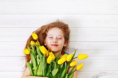 Little girl with bouquet of tulips. Stock Images