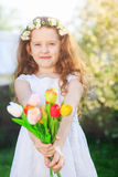 Little girl with bouquet of tulips. Royalty Free Stock Image