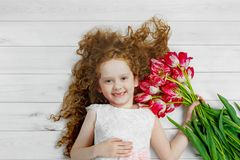 Little girl with bouquet of tulips. Mothers day concept, holiday Royalty Free Stock Photos