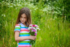 Little girl with bouquet of wildflowers Royalty Free Stock Image