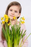 Girl with a bouquet of daffodils royalty free stock photography