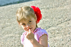 Little girl with a bow Stock Photos