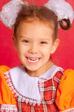 Little girl with bows in hair. On red background stock photo