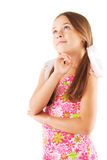Little girl with bows thinking. White background Royalty Free Stock Photo