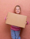 Little girl with box Stock Image