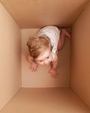 Little girl in the box Royalty Free Stock Photos
