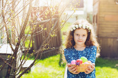 Little girl with a box of eggs in her hand. Royalty Free Stock Images
