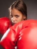Little girl boxer. Little girl wearing red boxing gloves Stock Images