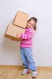 Little girl with boxes Stock Image