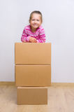 Little girl with boxes Stock Photography