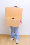 Little girl with boxes Royalty Free Stock Photos