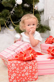 Little girl with boxes of presents Stock Image