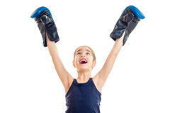 Little girl boxing winner screaming with hands up in the air Royalty Free Stock Image