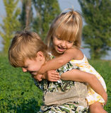 Little girl and boy. Beautiful  little girl and boy in the field Royalty Free Stock Photos