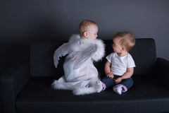 Little girl and boy in angel dress. Photo of little girl and boy in angel dress Stock Photography