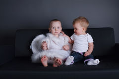 Little girl and boy in angel dress. Photo of little girl and boy in angel dress Royalty Free Stock Image