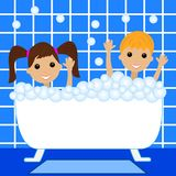 A little girl and boy bath in bath with foam Stock Images
