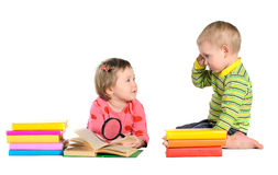 Little girl and boy with books stock photo