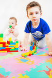Little girl and boy are building a house out of block Royalty Free Stock Images