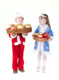 Little girl and boy in christmas clothes with toys. Isolated on white Royalty Free Stock Photography