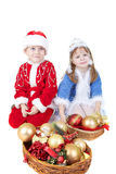 Little girl and boy in christmas clothes with toys. Isolated on white Stock Image