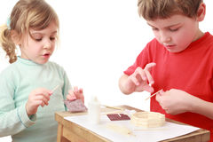 Little girl and boy crafts at small table Royalty Free Stock Photo
