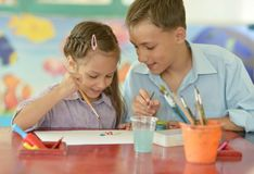 Little girl with boy drawing Royalty Free Stock Images