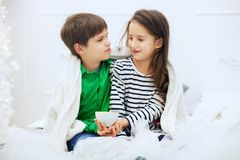 The little girl and boy drinks tea. The concept of love and Vale. Ntine`s Day Stock Photos
