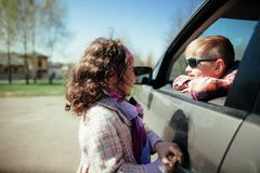 Little girl and boy driving car Stock Photo