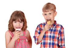 Little girl and boy eat ice cream Royalty Free Stock Photography