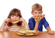 Little girl and boy eat pizza Royalty Free Stock Image