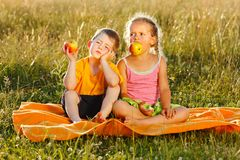 Little girl and boy eating apple royalty free stock photography