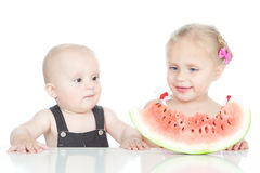 Little girl and boy eating a watermelon Stock Photos