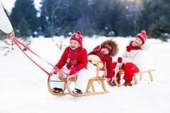 Kids on sleigh. Children sled. Winter snow fun. Royalty Free Stock Photos