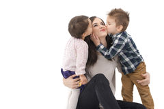 Little girl and boy kissing their mother isolated Stock Photos