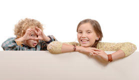 Little girl and boy looking through imaginary Stock Photography