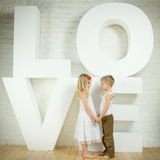 Little girl and boy - love. Beautiful little girl and boy - love Royalty Free Stock Images