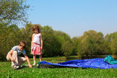 Little girl and boy making tent Royalty Free Stock Image