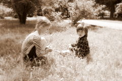 Little girl and boy outdoors, retro Royalty Free Stock Photo