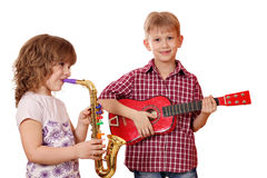 Little girl and boy play music Stock Photo
