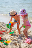 Little girl and boy playing on the beach Royalty Free Stock Photo
