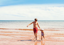 Little girl and boy playing on the beach Royalty Free Stock Image
