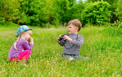 Little girl and boy playing with binoculars Royalty Free Stock Images