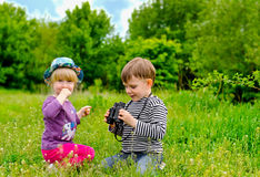 Little girl and boy playing with binoculars Royalty Free Stock Photo