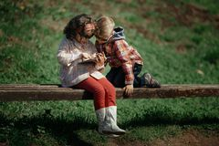 Little girl and boy playing outdoor Stock Photos