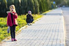 Little girl and a boy playing outdoors. Children activity. Stock Photography