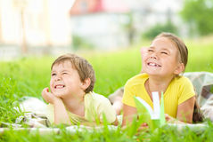 Little girl and boy are playing outdoors Stock Photography